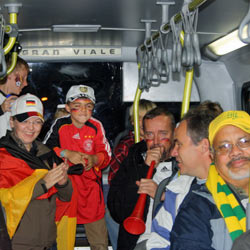 German and Brazilian fans share space in a crowded Rea Vaya bus