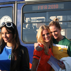 Miss World representatives prepare to catch a Rea Vaya bus to Soccer City